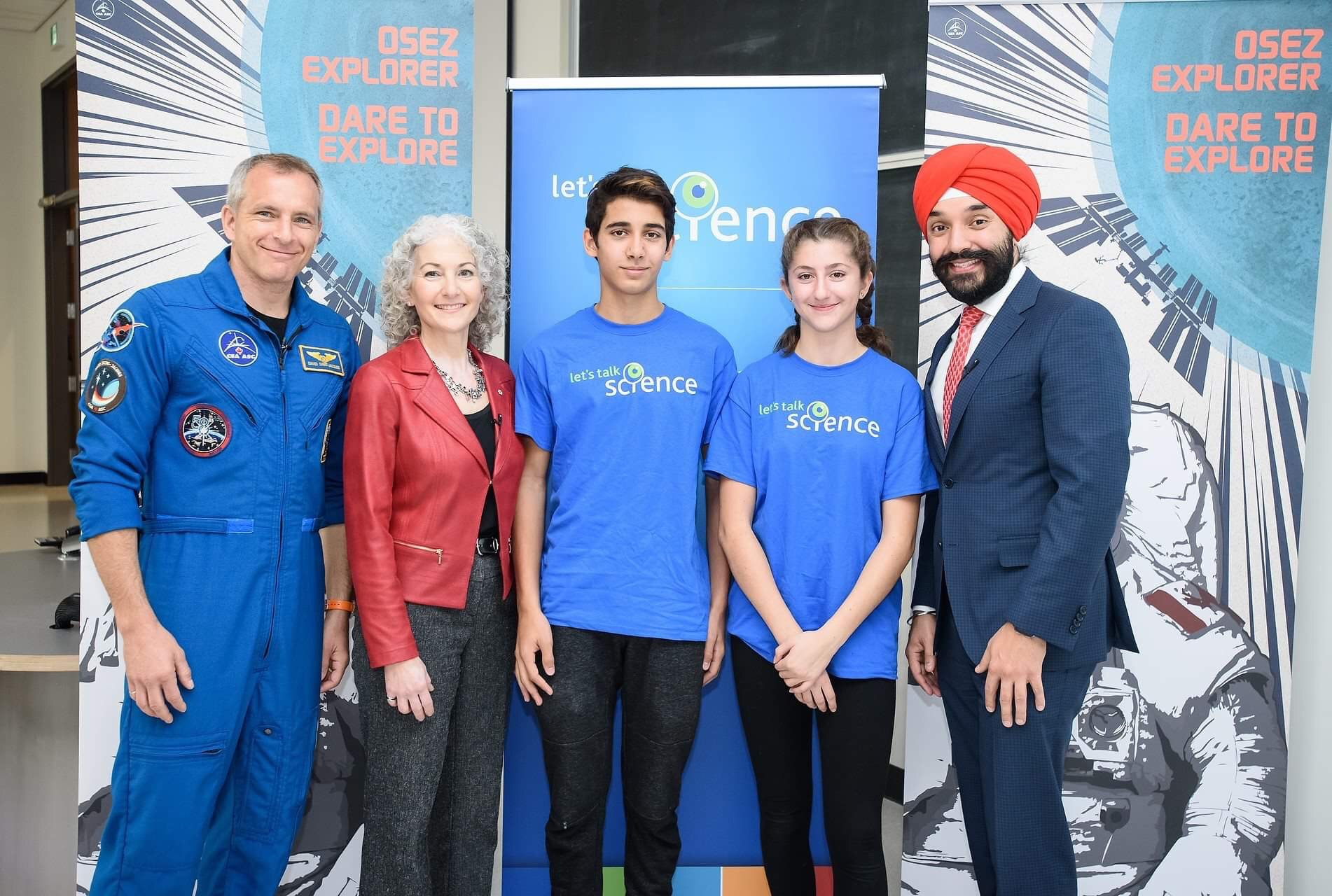 Canadian Space Agency Astronaut David Saint-Jacques, Let's Talk Science President Bonnie Schmidt, Outreach volunteers and the Honourable Navdeep Bains pose together at an event in Ottawa.